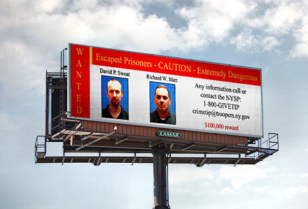 Lamar Digital Billboard with escaped inmates' information